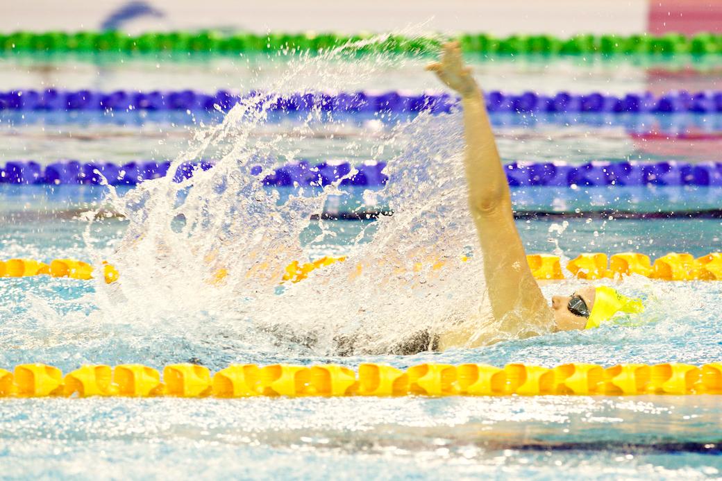7月13日、女子100メートル背泳ぎS9の予選と決勝で世界記録の更新をかさねたオーストラリアのエリー・コーレの泳ぎ 写真・佐々木延江